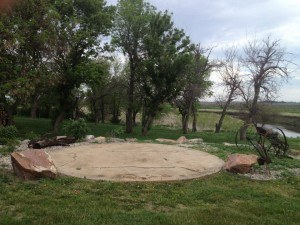 Round concrete pad cracked and ugly