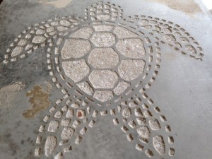 Decorative concrete mosaic turtle with template removed
